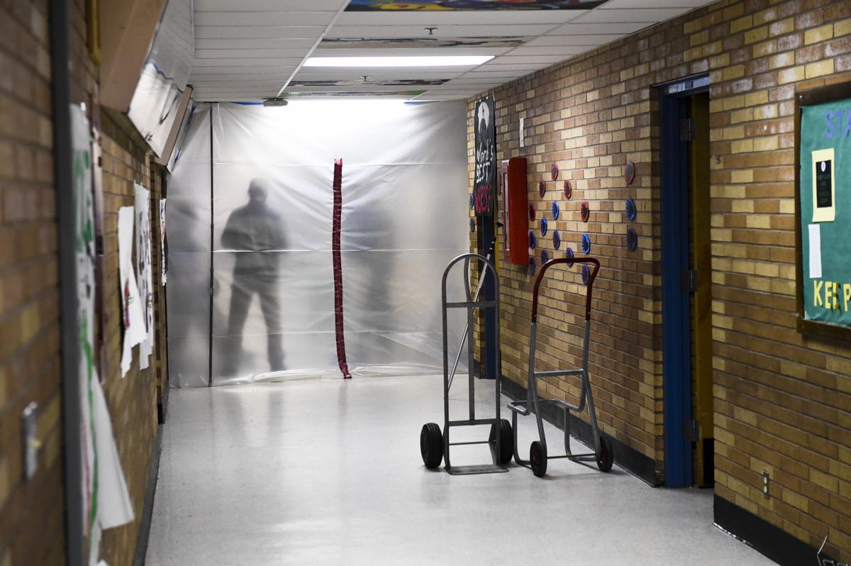 A hallway in C.R. Anderson Middle School is sealed off while school officials