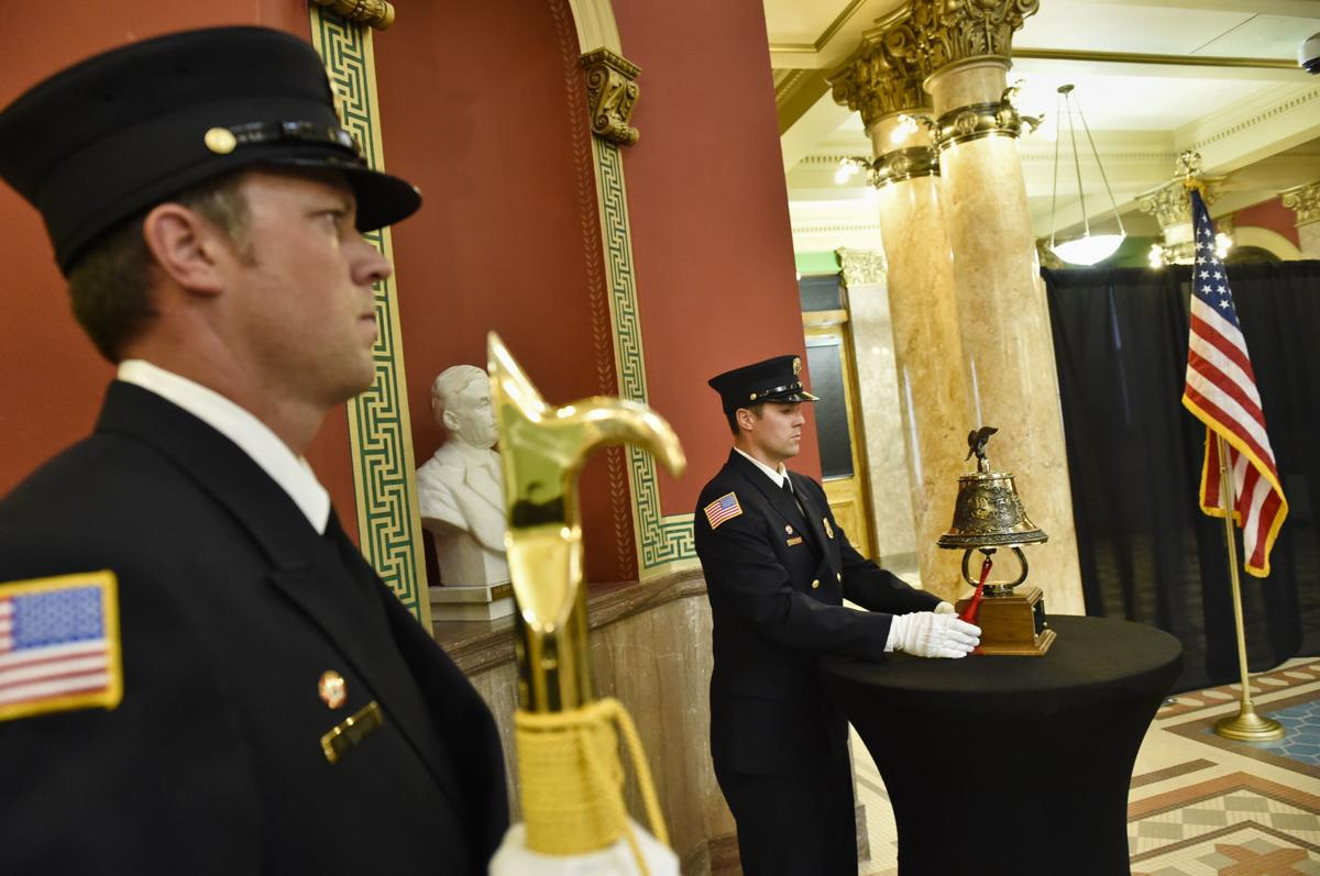 Helena Firefighter Nick Anderson rings a bell signifying a symbolic end of watch