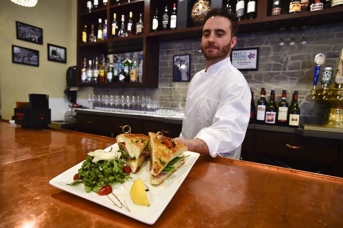 Chef and proprietor Davide Giulliani tables a panini