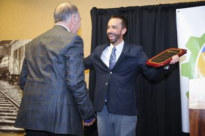 Jason Davis, awards Dick Anderson the business of the year