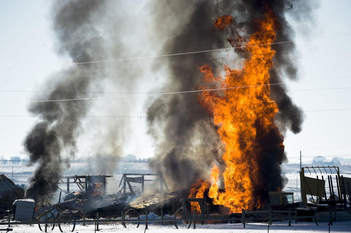 Buildings burn to the ground Tuesday near York Road and Lake Helena Drive after a propane tank exploded.