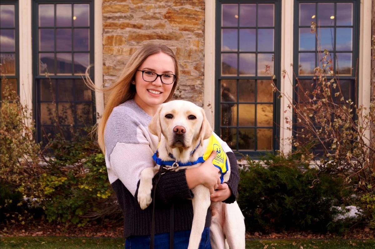 Ashley Wilt with Canine Companions puppy Phil.