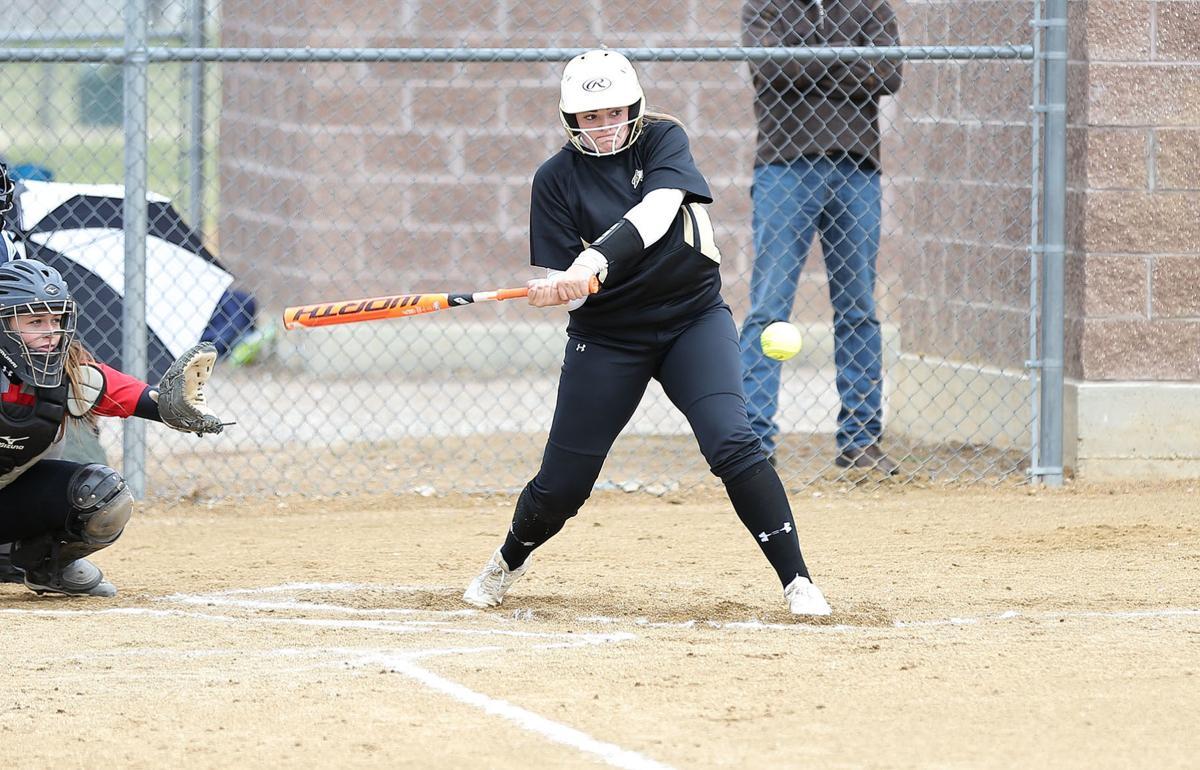 Helena Capital's Shelby Martin hits a double to center field