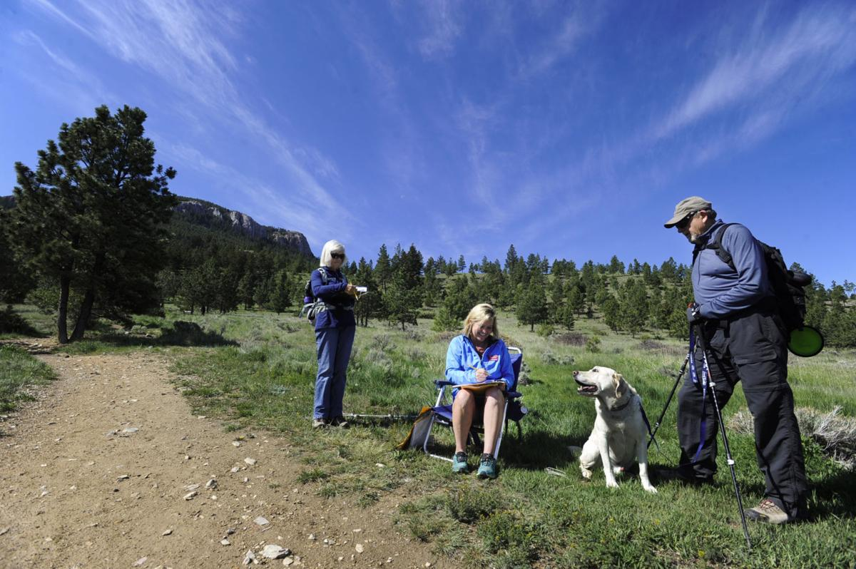 Karen Reese, center, conducts a trail survey of Pat, left, and Ted Reichert Friday morning at the Tubbs Trailhead.