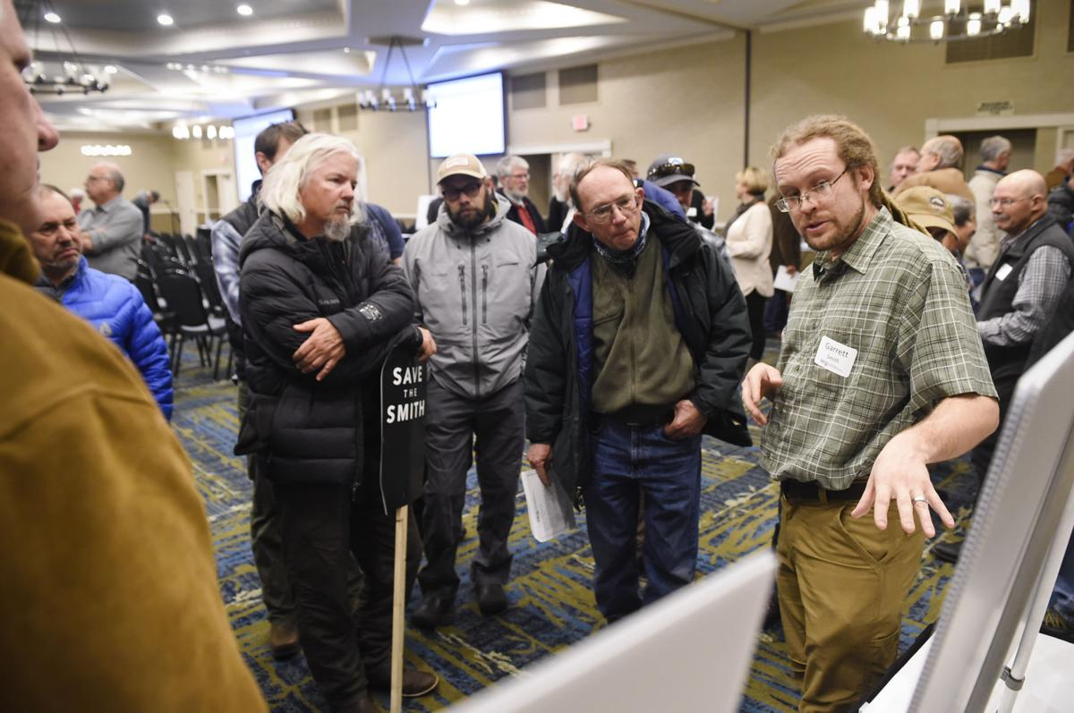 Garrett Smith, a geochemist for the Department of Environmental Quality, answers questions about the proposed copper mine near the Smith River Monday evening during a public meeting about the mine.