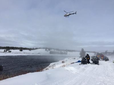 Snowmobile crash into Madison River