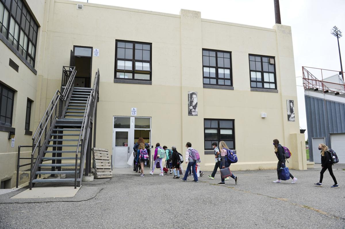 Helena Middle School sixth grade students trickle into the building Monday morning