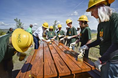 Gov. Steve Bullock works alongside members of the Montana Conservation Corps' Middle School Youth Program
