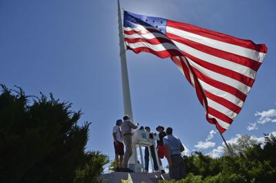 The Old Glory's old guard shows its new caretakers
