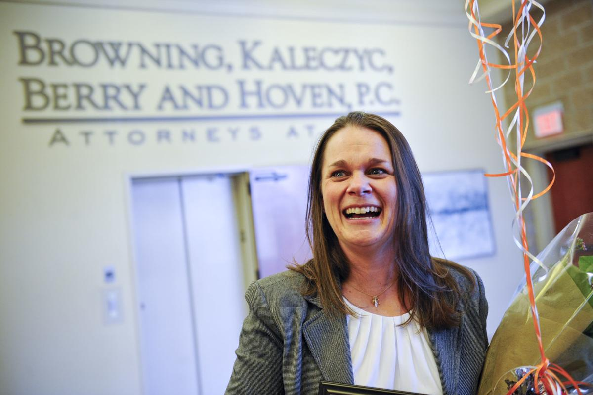Sara Berg receives the YWCA Woman of the Year Award Wednesday afternoon.