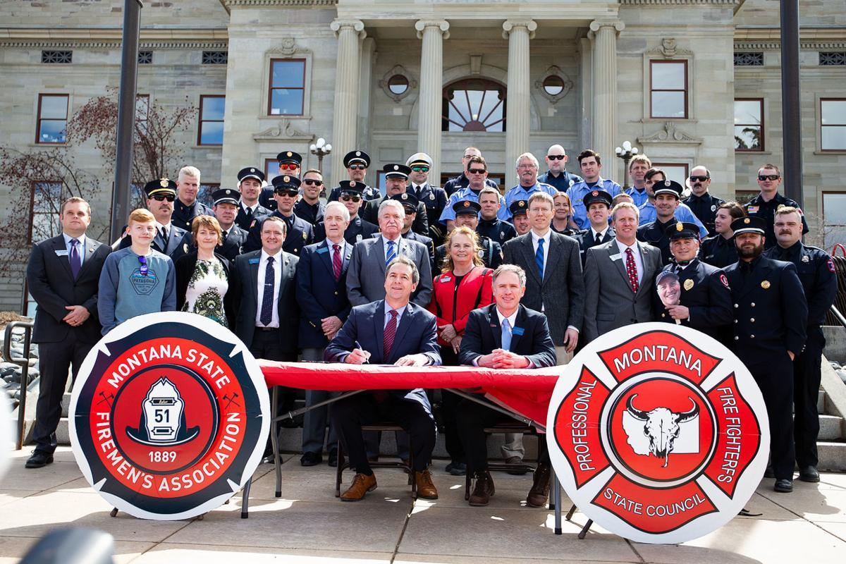 Gov. Steve Bullock signs the Firefighter Protection Act