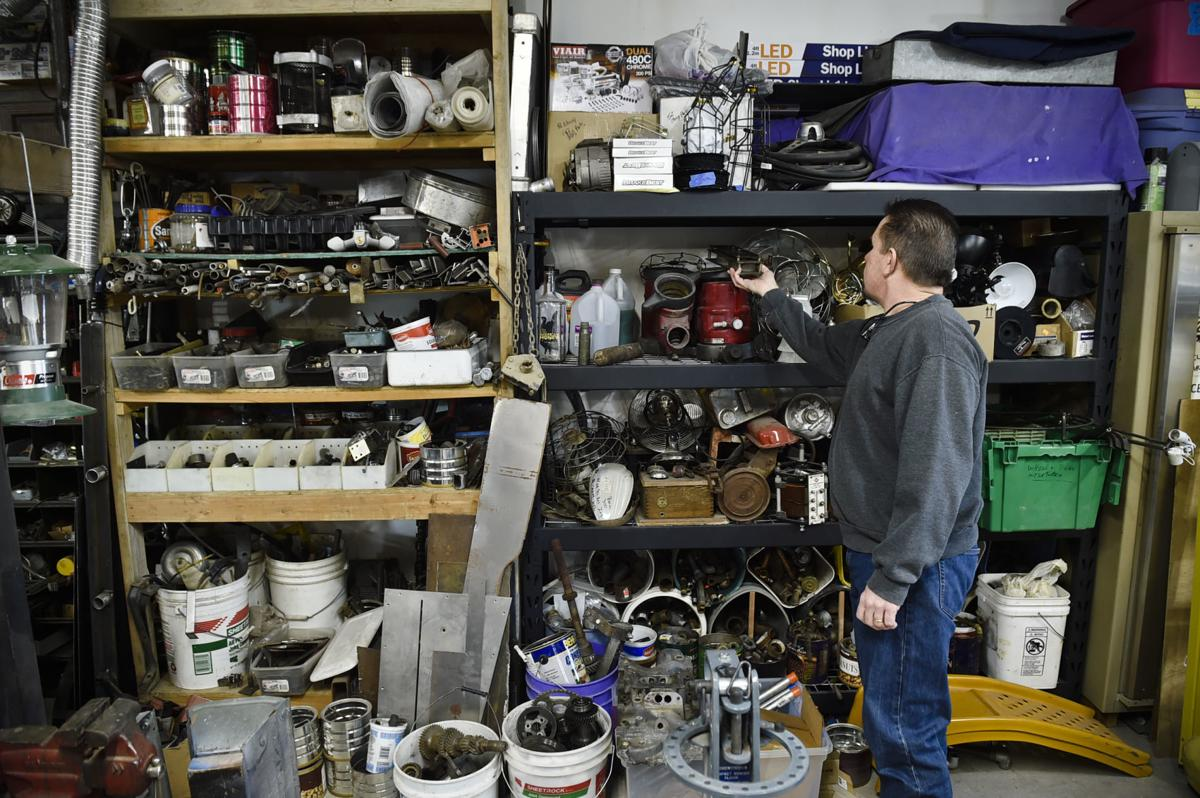 Reich sifts through his collection of antique parts