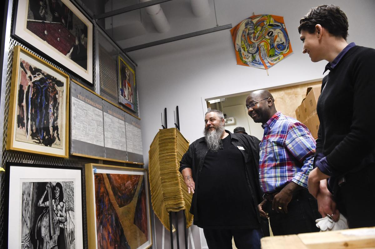 From left, Executive Director Chris Riccardo, Mayor-elect Wilmot Collins and assistant curator Jennifer duToit-Barrett look through the Holter Museum of Art's collection Wendesday morning.