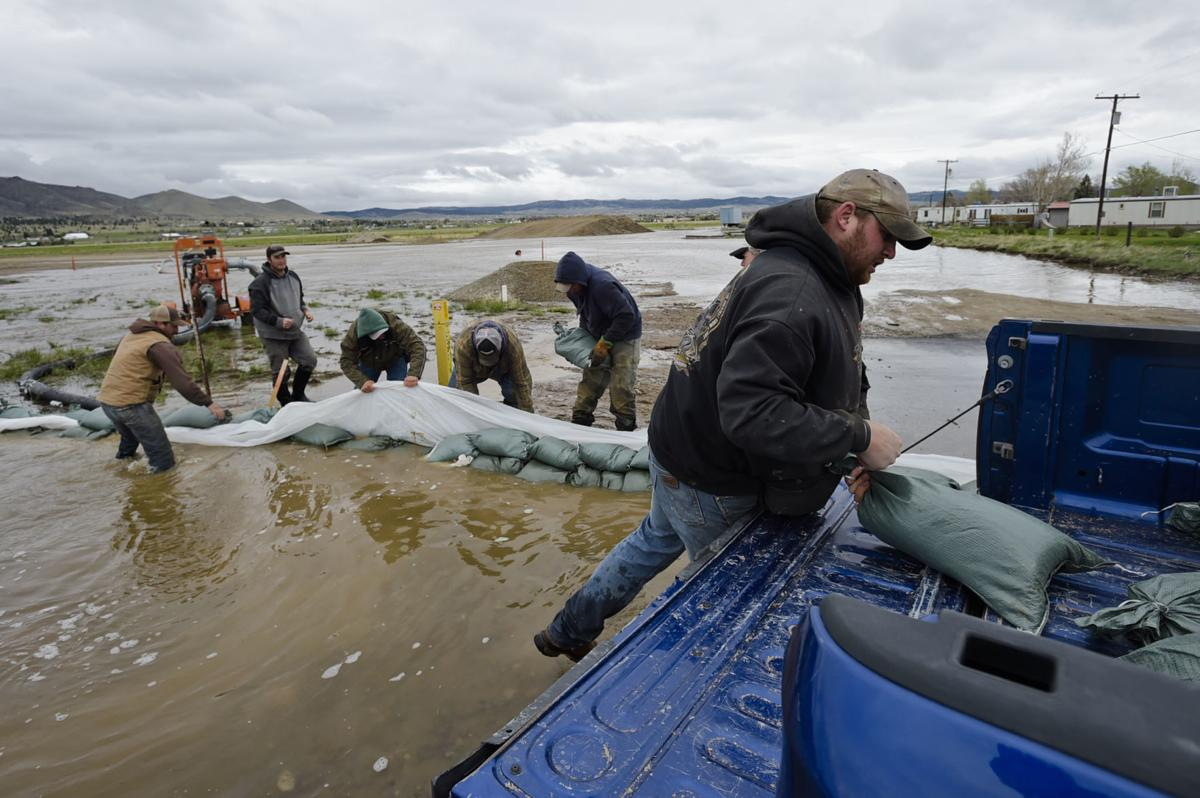 Sandbagging continues in the Helena Valley Friday as floodwaters from Ten Mile Creek keep rising.