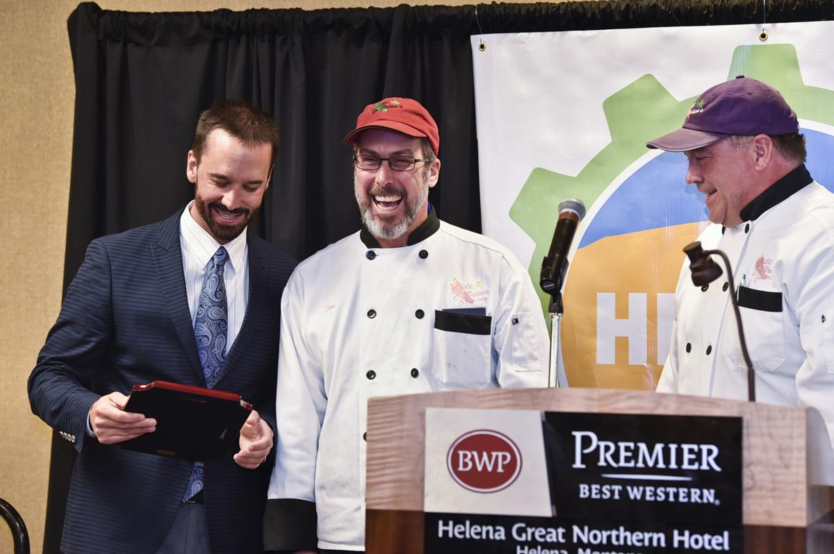 Jason Davis, left, awards the owners of Chili O'Brien's