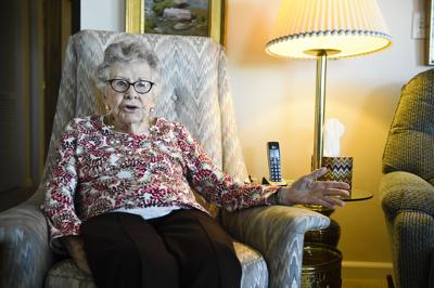 Mary Munger discusses her acts of philanthropy Thursday afternoon in her apartment.