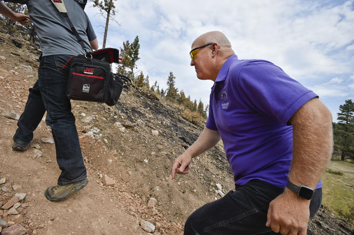Tri-Lakes Fire Chief Bob Drake, runs up the hill near the ignition point