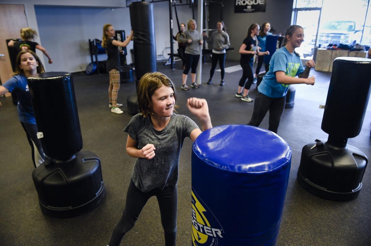 Kaylee Sexton, 11, punches a bag Tuesday afternoon at Capital City Health Club while taking a kickboxing class with the Girls Thrive program.