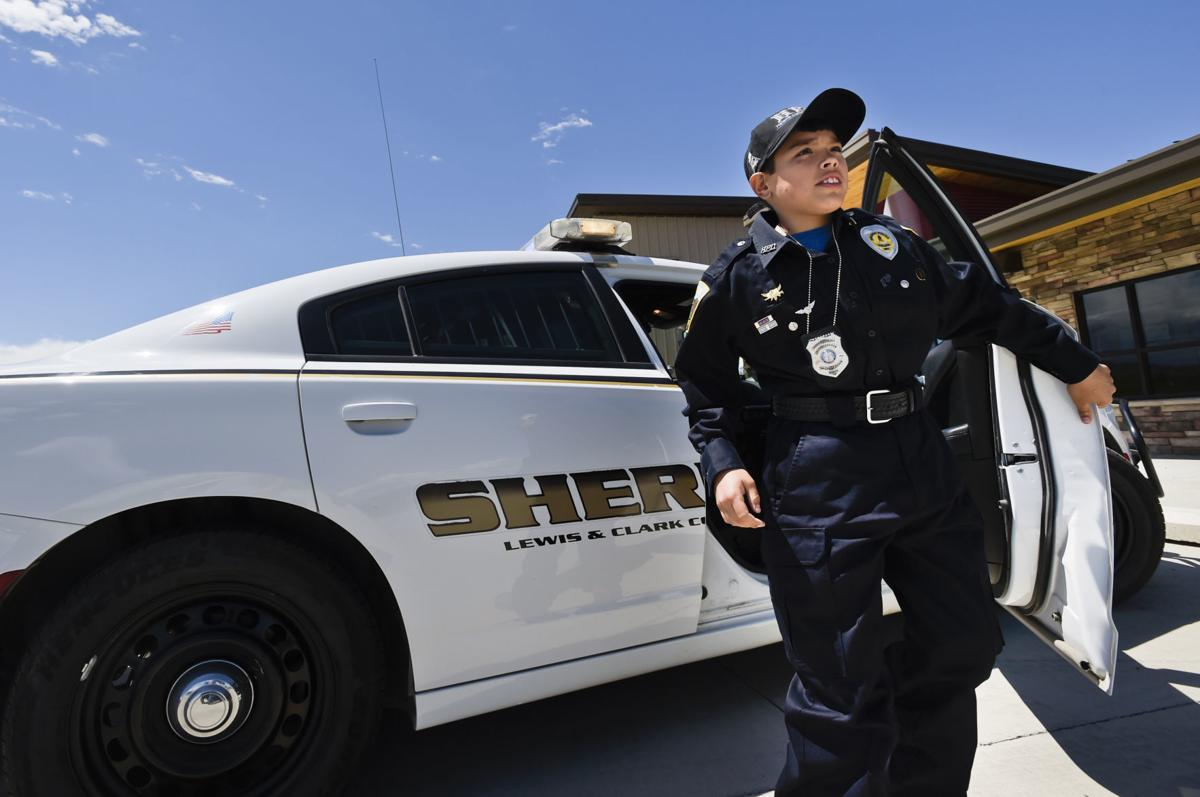 Jacob Hartford-Corpron, 11, steps out of a sheriff's vehicle Friday