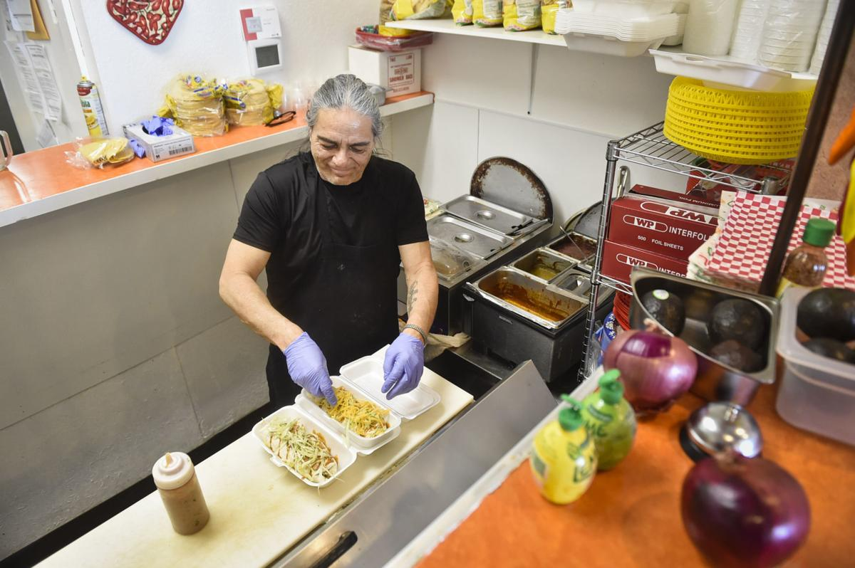 Louie Lopez prepares a couple burritos