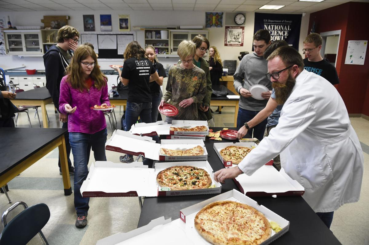 Helena High School Science Olympiad students celebrate their state championship win with a pizza lunch Tuesday afternoon at the school.