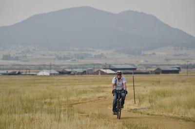 A bicyclist rides through Ten Mile Creek Park