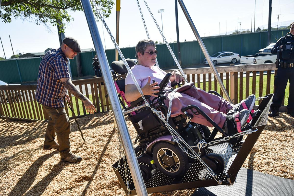 Theresa Gardner gets a push in a new wheel chair capable swing