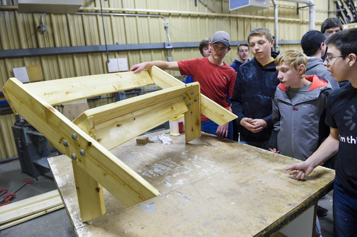 Helena High woodworking students look over their work Thursday morning