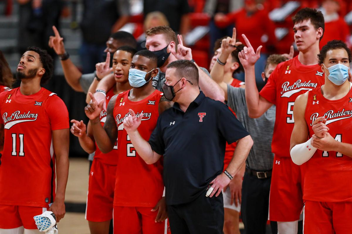 On December 6, 2020, Texas Tech guards Kyler Edwards and Jamarius Burton, head coach Chris Beard, center Vladislav Goldin and forward Marcus Santos-Silva and the rest of the Red Raiders stand for The Matador Song after a game against Grambling State at United Supermarkets Arena in Lubbock, Texas.