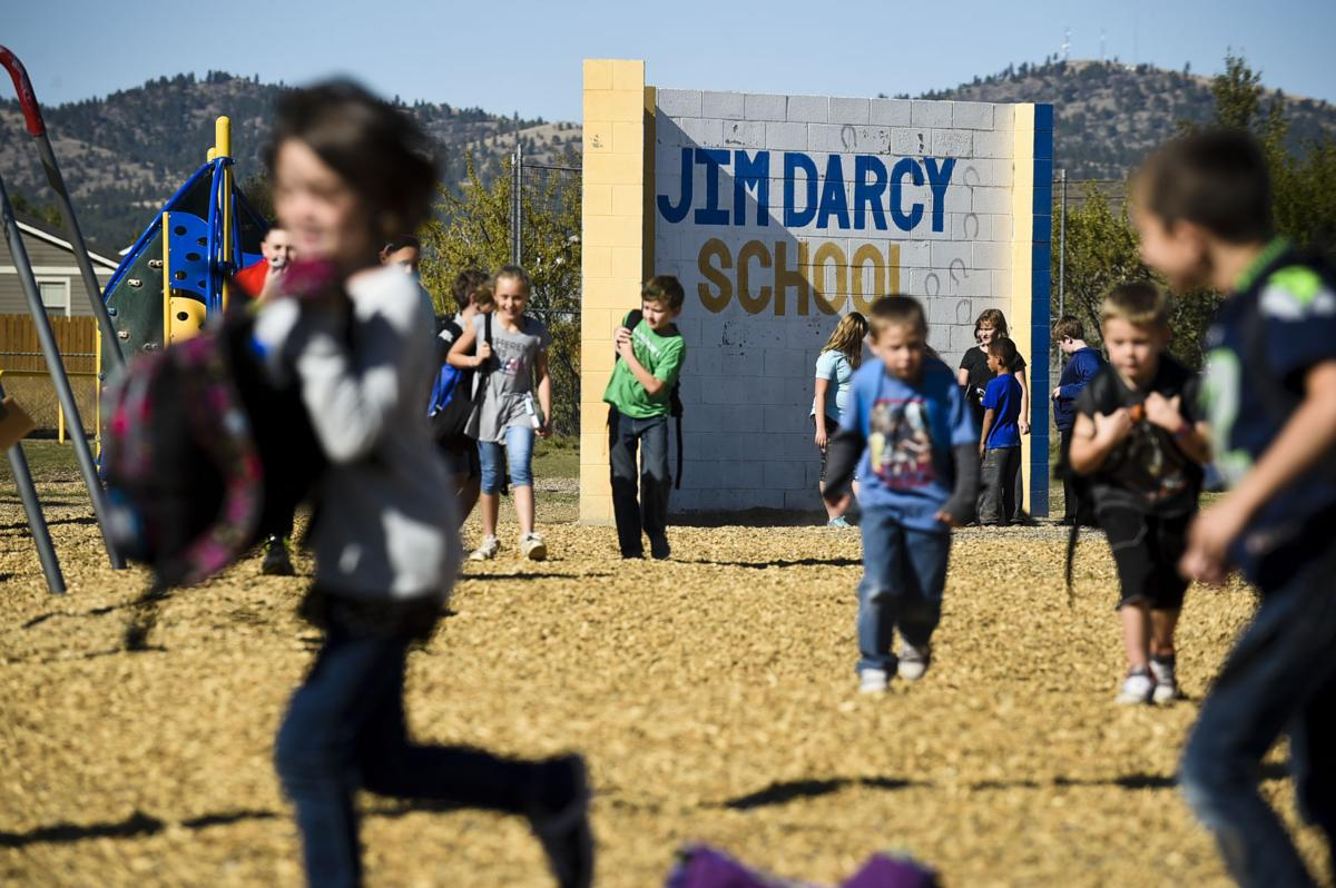 Students run around the Jim Darcy Elementary School playground after school recently.