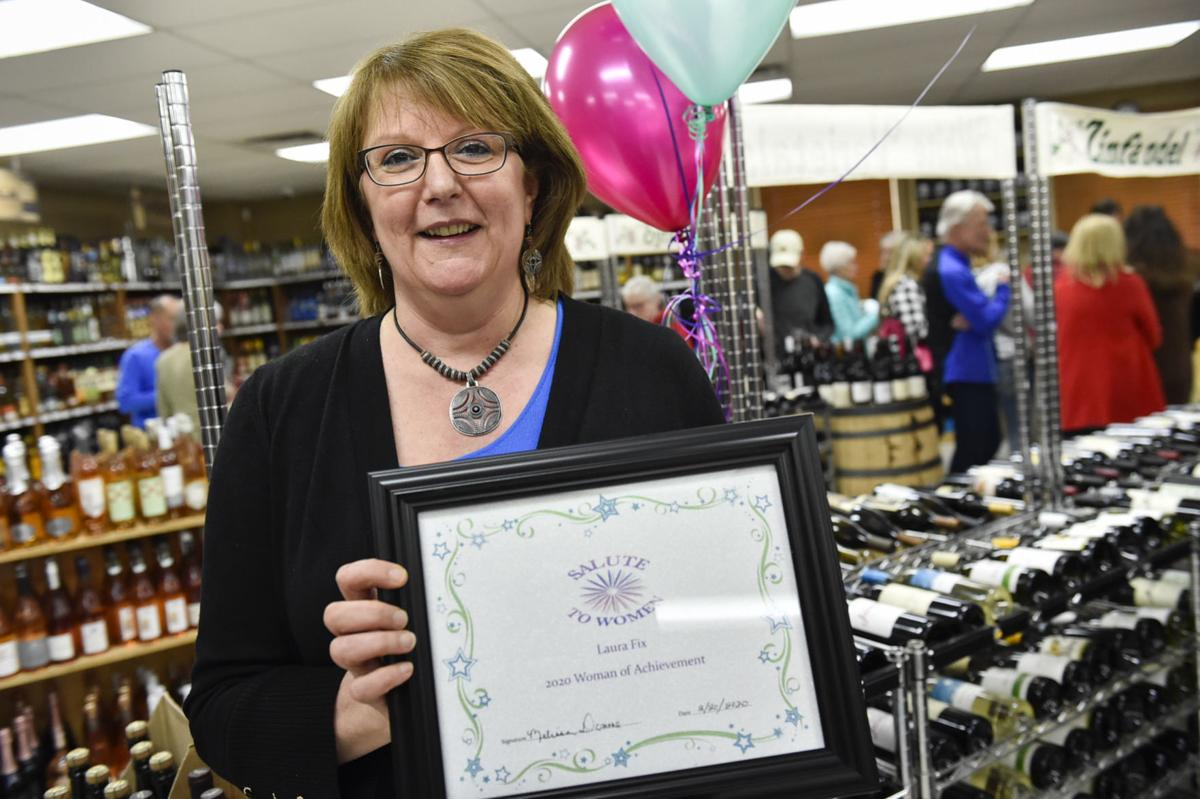 Laura Fix from Island Liquor store receives the Woman of Achievement Award Thursday evening.