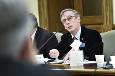 Rep. Tom Woods (D-Bozeman), right, debates