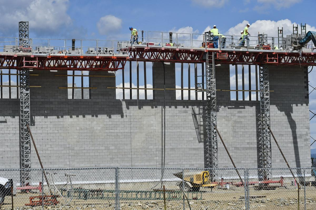 Contractors continue to work on the wall of the new East Helena High School