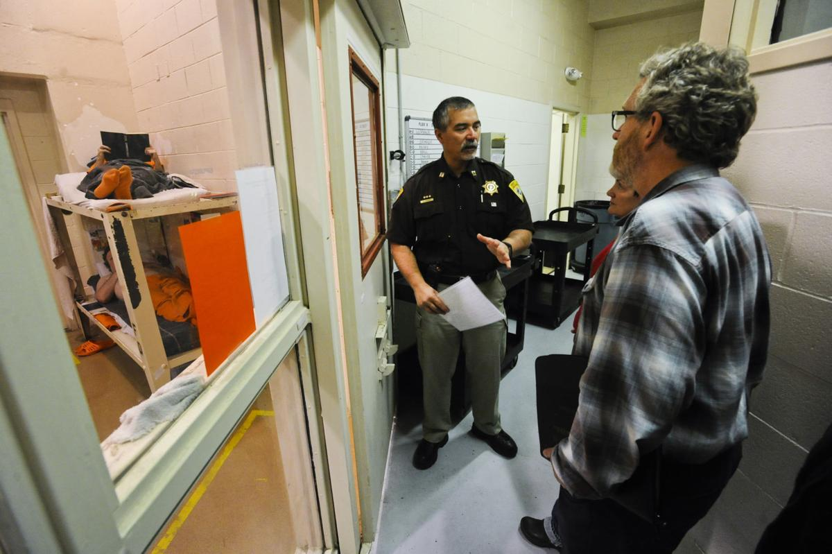 Capt. Alan Hughes, center, leads a tour of the Lewis and Clark County Detention Center Thursday afternoon.