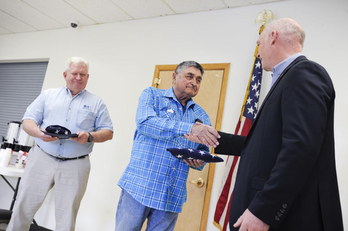 U.S. Rep. Greg Gianforte awards Daniel LaFromboise, center, and Stephen Garrison