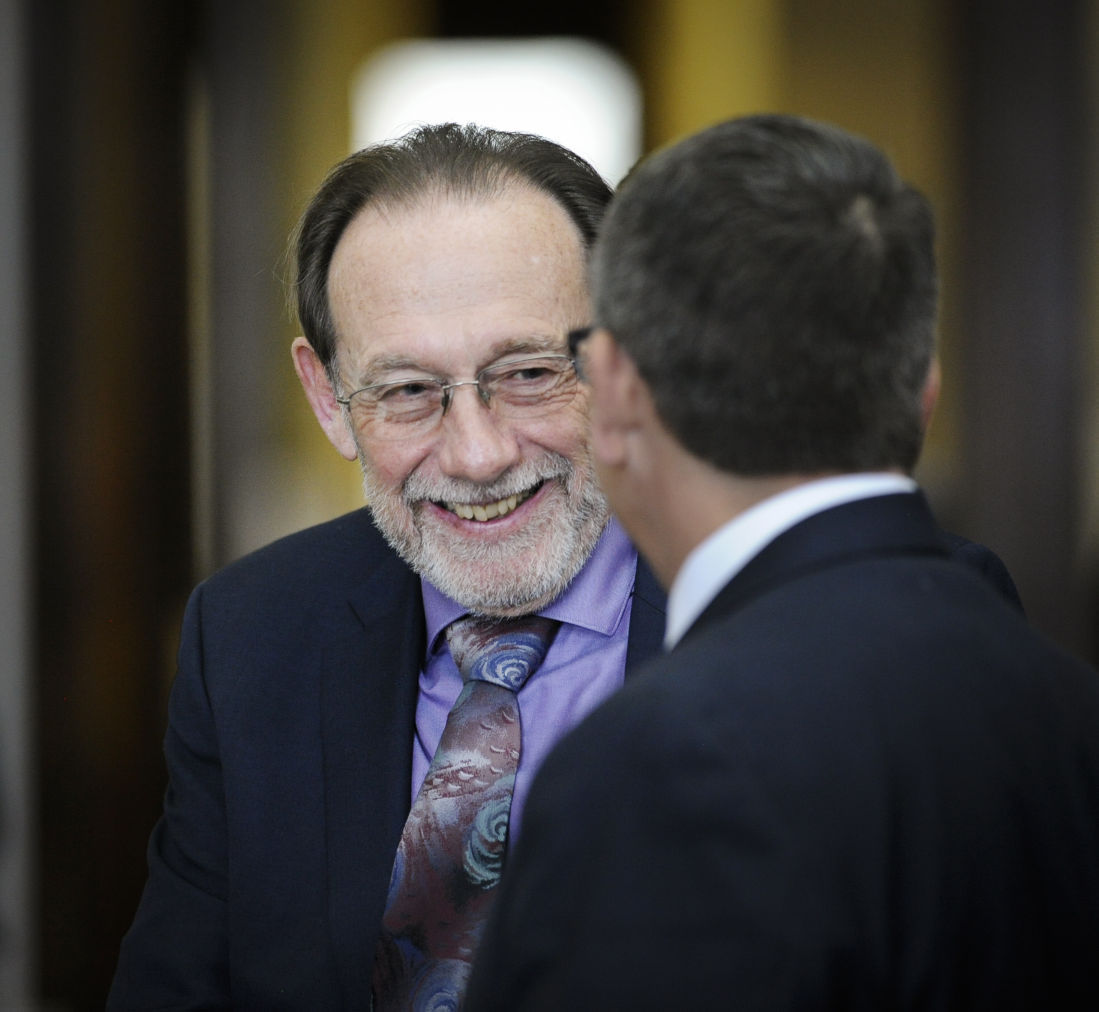 James Stiffler grins as he shakes his defense attorney