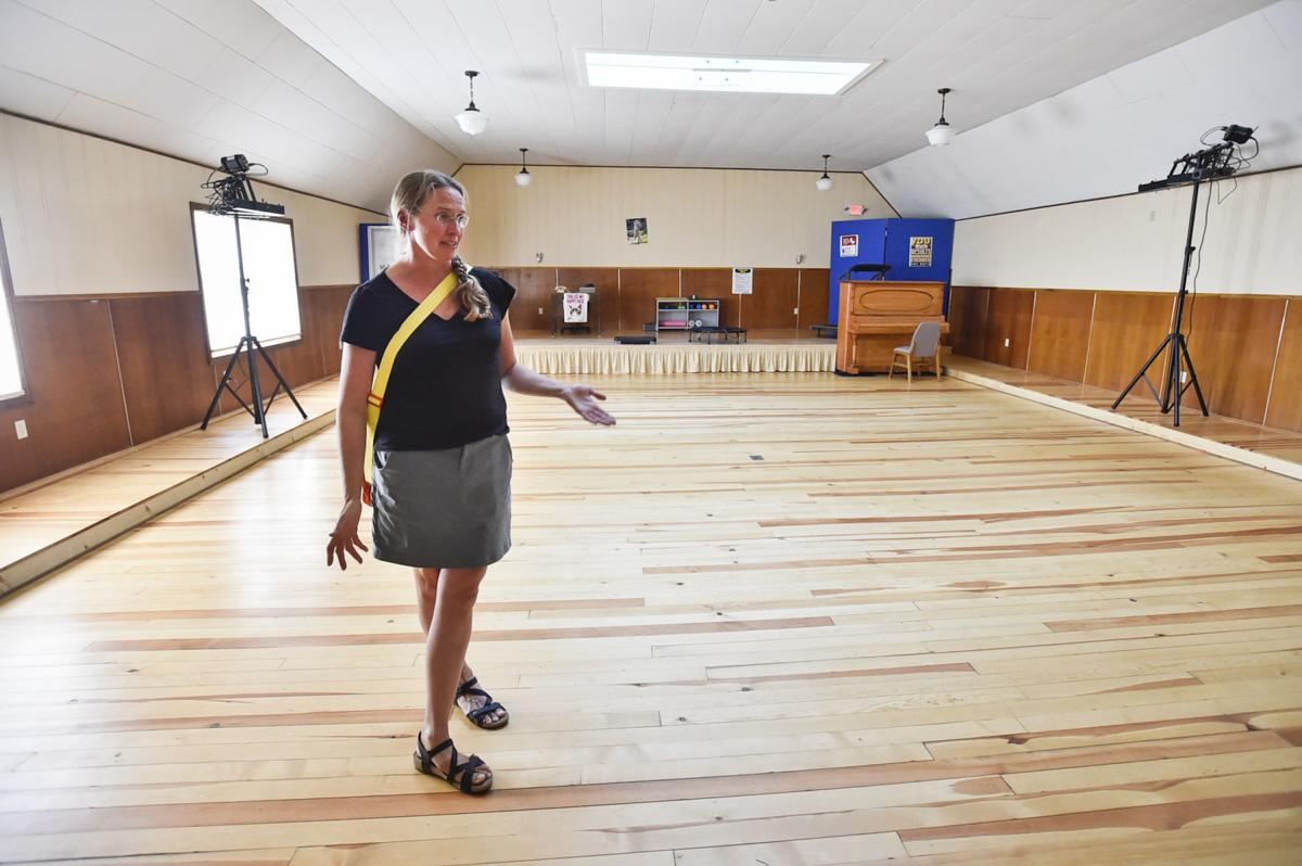 Tina Homman shows off a large gathering room of The Lodge of Townsend,