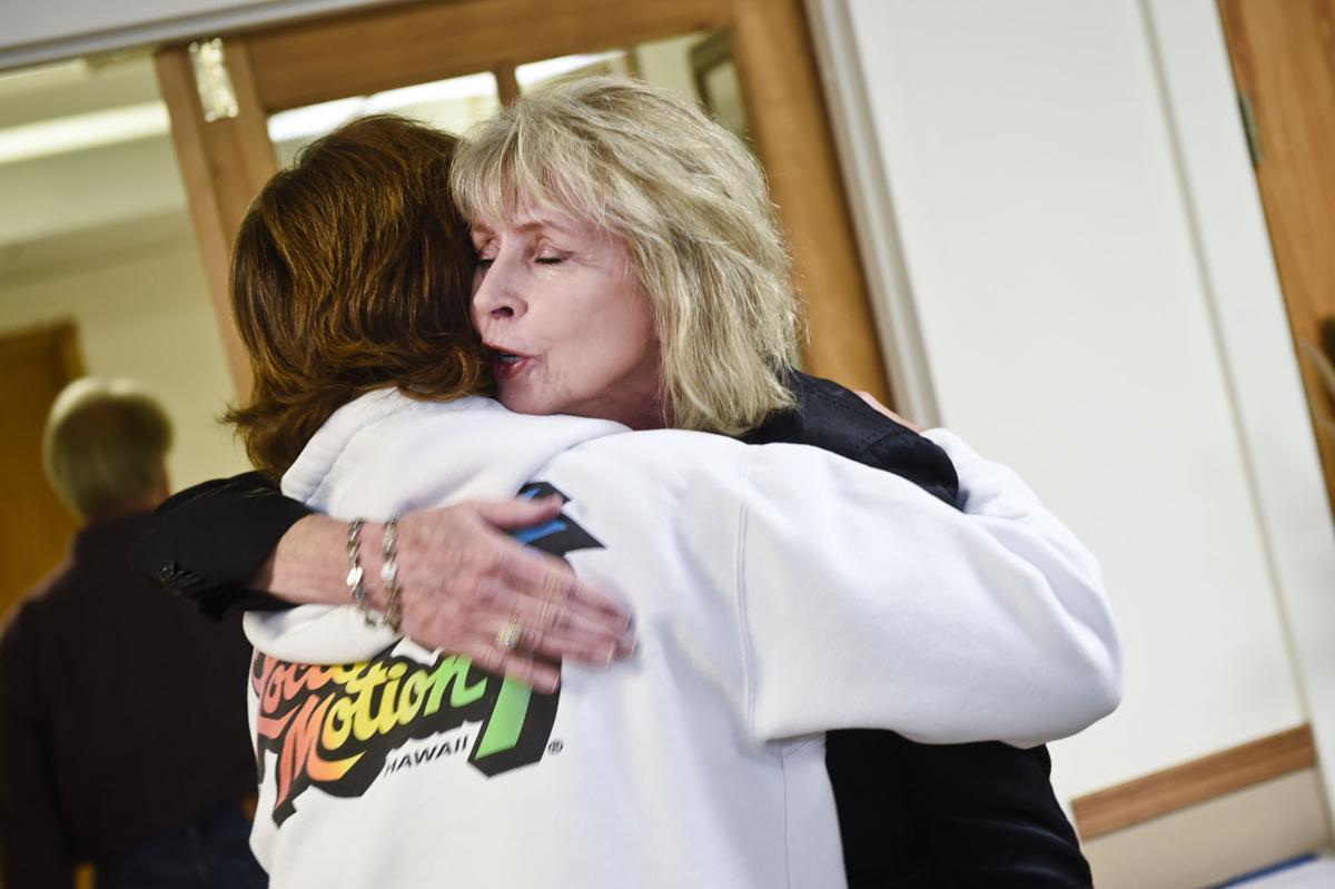 Medley receives a congratulatory hug Monday morning.