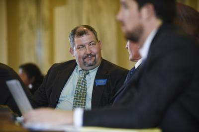 Rep. Rob Cook (R-Conrad) converses with fellow representatives during a recess Tuesday morning at the State Capitol.