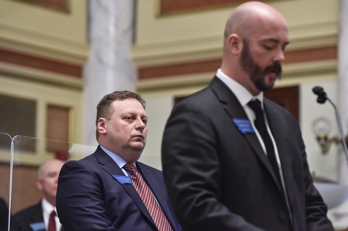 Senate President Mark Blasdel, R-Kalispell, left, watches