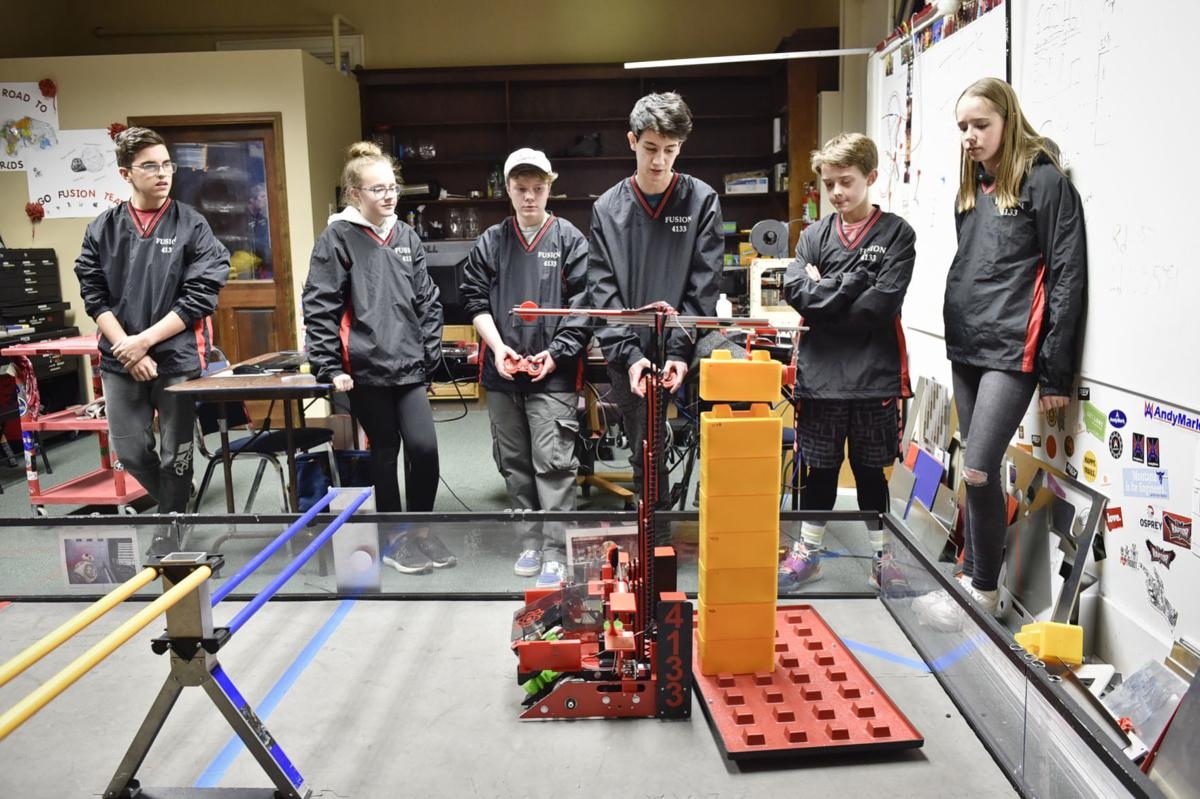 The Fusions Robotics team operates Oracle, the robot they will take to the world robotic competition this year.