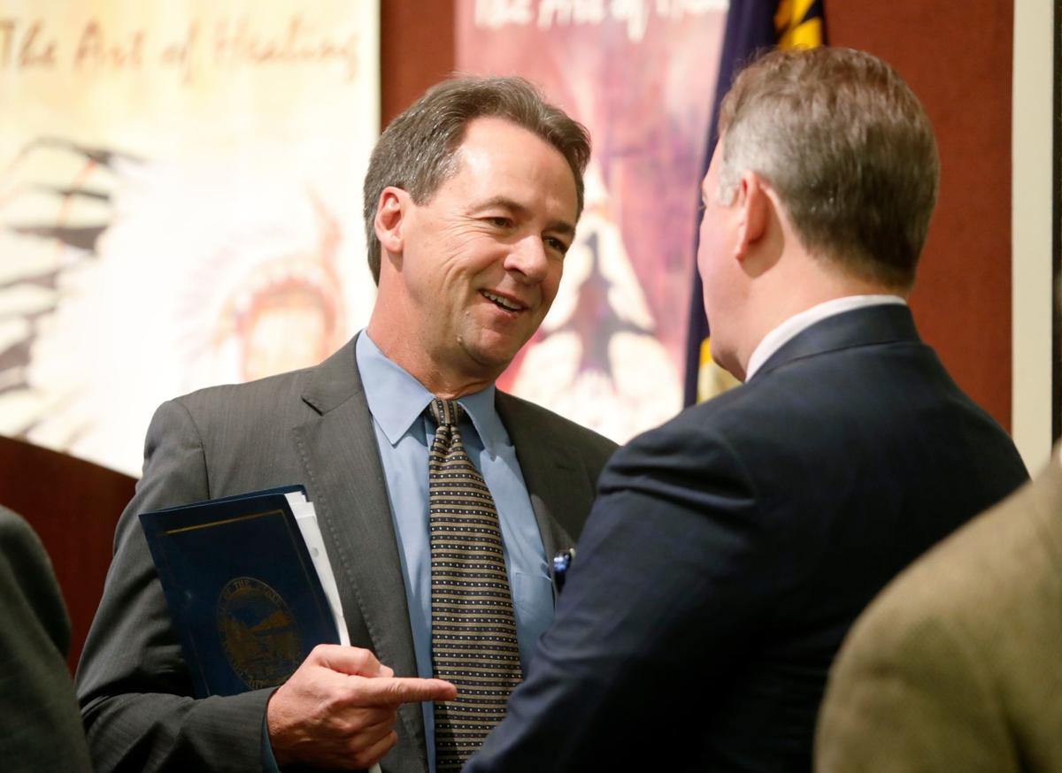 Montana Gov. Steve Bullock, left, talks with Billings Clinic CEO Dr. Randall Gibb