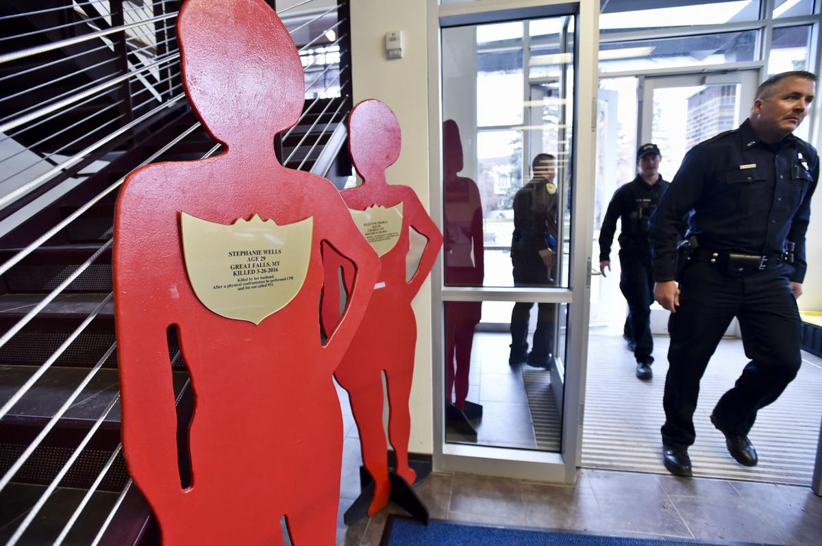 Montana Law Enforcement Academy cadets walk to class Wednesday past the Silent Witness Exhibit