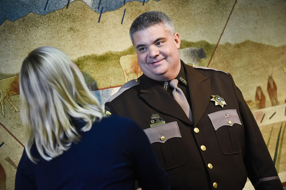Lewis and Clark County Sheriff's deputy Greg Holmlund receives the Officer of the Year Award Monday morning.