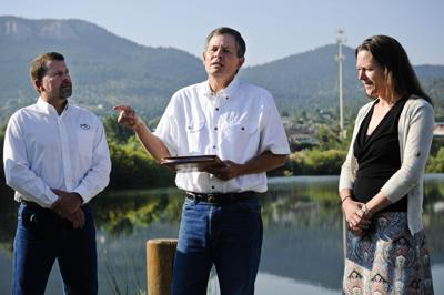 U.S. Sen. Steve Daines, center, flanked by Mary Hollow with Prickly Pear Land Trust, right, and Mark Lambrecht with Rocky Mountain Elk Foundation,