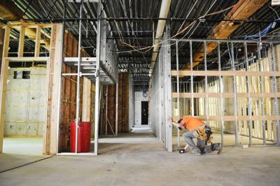 A contractor works on Capital High School main office Thursday.