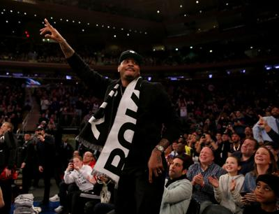 Former New York Knicks player Carmelo Anthony waves to the fans in the first quarter against the Miami Heat at Madison Square Garden on January 27, 2019 in New York City. (Elsa/Getty Images/TNS) *FOR USE WITH THIS STORY ONLY*