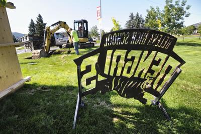 Contractors prepare the site for a new Helena High School sign