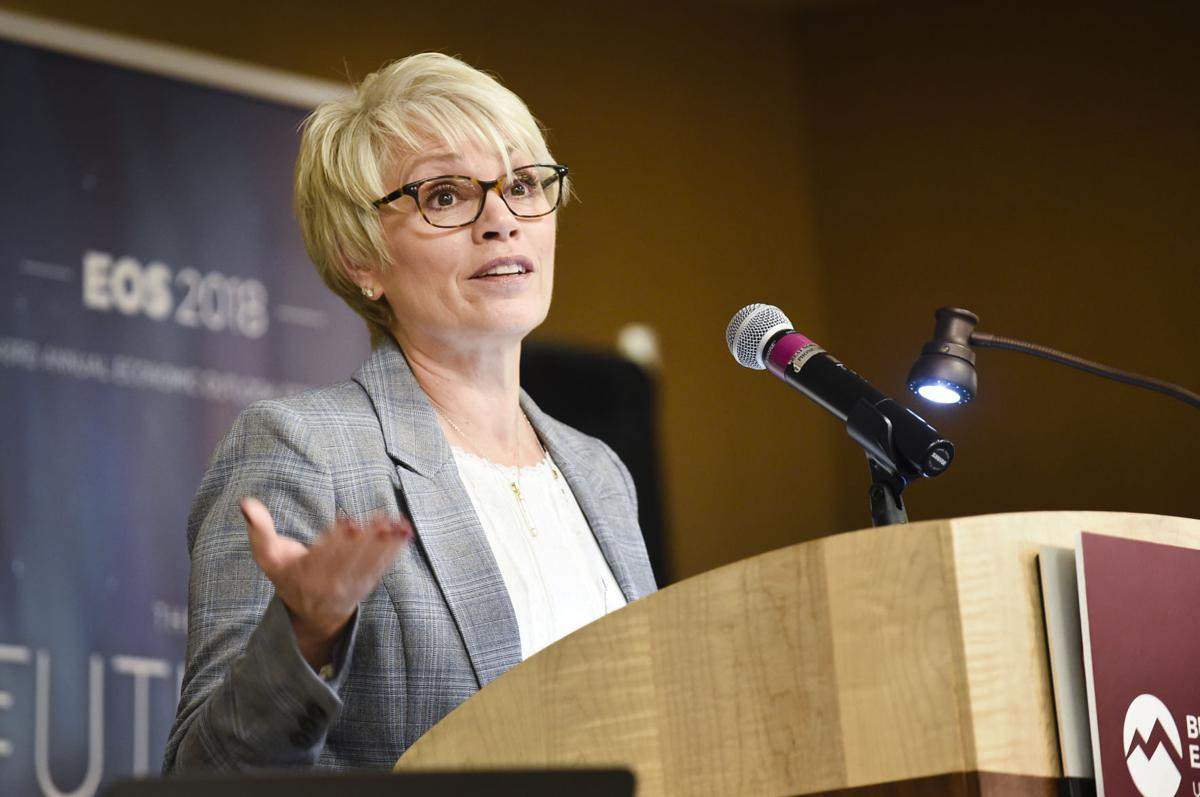 Pam Haxby-Cote, director of Montana's Department of Commerce, speaks during Tuesday's economic seminar in Helena.