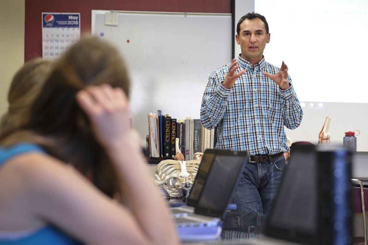Health Careers teacher Manny Garza lectures students recently at Helena High School